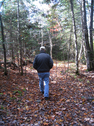 Ken walking in woods